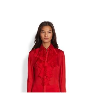 A red designer blouse made 100% from silk/sole.